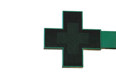 Pharmacy sign isolated. Green pharmacy cross with LED backlight. Royalty Free Stock Images