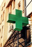 Medical cross, pharmacy, sign, green, cross, symbol, building, emergency, medical, medicine, store, drugstore, health,. Pharmacy sign on the street, Green royalty free stock photo