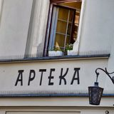 Pharmacy sign, on the wall of an old building in Krakow. Poland. stock photo