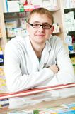 Pharmacy specialist in drugstore stock image