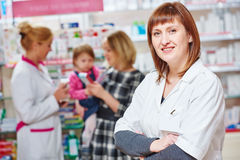 Pharmacy store. Female pharmacist portrait stock photos