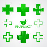 Pharmacy symbols in green color on white Stock Images