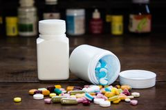 Pharmacy theme, capsule pills with medicine antibiotic in packages. royalty free stock image