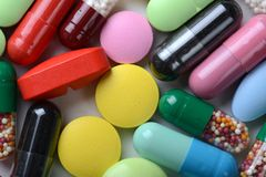 Pharmacy theme. Multicolored Isolated Pills and Capsules Royalty Free Stock Photos