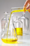 Pharmacy, yellow liquid pour in Stock Photo