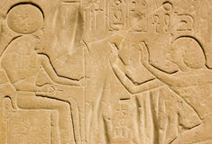 Pharoah Seti I and Horus. One of the stone carved steli at the Temple of Seti I on the West Bank of the Nile at Luxor, Egypt.  The Anvient Egyptian Pharoah Seti Stock Photo