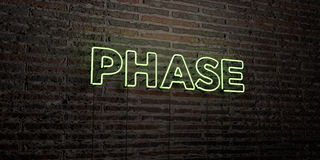 PHASE -Realistic Neon Sign on Brick Wall background - 3D rendered royalty free stock image. Can be used for online banner ads and direct mailers Royalty Free Stock Images