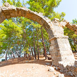 phaselis sea  bush gate  in  myra  the      old column  stone  c Royalty Free Stock Photography