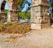 phaselis sea  bush gate  in  myra  the      old column  stone  c Royalty Free Stock Photos