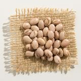 Pinto Bean legume. Close up of grains over burlap. Phaseolus vulgaris is scientific name of Pinto Bean legume. Also known as Frijol Pinto and Feijao Carioca Stock Photography
