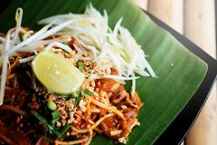 Phat thaior Pad thai is a famous Thailand tradition cuisine with fried noodle served on banana leaf. And have some space for wording background Stock Image