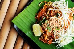 Phat thaior Pad thai is a famous Thailand tradition cuisine with fried noodle served on banana leaf. And have some space for wording background royalty free stock images