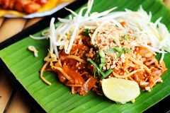 Phat thaior Pad thai is a famous Thailand tradition cuisine with fried noodle served on banana leaf royalty free stock photos