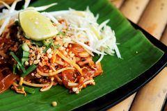 Phat thaior Pad thai is a famous Thailand tradition cuisine with fried noodle served on banana leaf stock photos