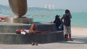 Phatthaya, Thailand - circa January 2018: Nice monument on quay on Beach Road in Phatthaya stock video footage