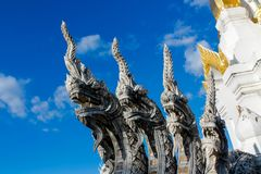 Naga stone dragon snake guard in thai buddhist Temple. Phaya Naga guarding the Temple Wat in Thailand. Nagas asian mythological guard statue in Thai Buddhist royalty free stock images