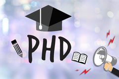 PhD Doctor of Philosophy Degree Education Graduation. Businessman working at office desk and using computer and objects, Gamification Business Concept royalty free stock photos