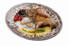 Pheasant baked Sous Vide on a decorative plate royalty free stock image