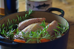 Pheasant in cooking pot royalty free stock image