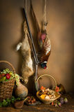Pheasant and hare. Autumn still life with hunting products, pheasant and hare Royalty Free Stock Photography