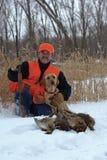Pheasant hunter and Labrador Retriever. A pheasant hunter poses with his Labrador retriever and the days harvest stock photography
