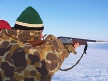 Pheasant Hunting. Hunter aiming rifle royalty free stock photography