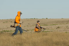 Pheasant Hunting. Pheasant Hunters on the prairie in North Dakota Royalty Free Stock Photography