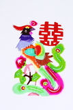 Phenix and Double Happiness. Paper-cutting is a traditional Chinese folk art. The design of Phenix and Double Happiness is for wedding decoration Stock Photo