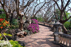 Phetchaburi, Thailand: Royal Palace Gardens. Brick pathways wind through the tropical hilltop gardens at the 1859 Royal Palace built by King Mongkut in Royalty Free Stock Image