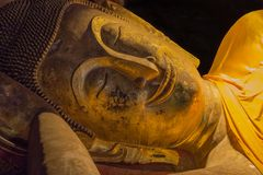 Reclining Buddha statues in Khao Luang Cave - Phetchaburi, Thailand. PHETCHABURI, THAILAND - SEPTEMBER 17: Headshot of Reclining Buddha statues on September 17 royalty free stock photo