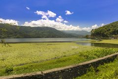 Phewa Lake a Colorful Sunny day Pokhara Nepal. Phewa Lake a Colorful Sunny day,blue sky with clouds and green hills Pokhara Nepal stock photography