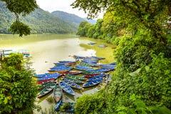 Phewa Lake, Pokhara, Nepal. Colorful wooden boats on Phewa Lake, Pokhara, Nepal stock images