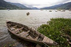 Phewa Lake, Pokhara, Nepal. Wooden boats on Phewa Lake after a storm, Pokhara, Nepal royalty free stock images