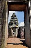Phi mai temple. Old building  in door frame  with blue sky. Old temple in thailand Royalty Free Stock Photography