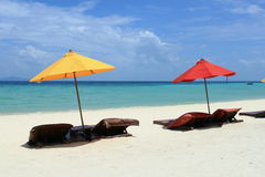 Phi Phi island. Red and yellow umbrellas on Phi Phi island, Thailand royalty free stock photo