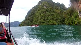 PHI PHI ISLAND - KRABI - THAILAND 2016 Year, December 29: Boat trip to tropical islands. The View from the Inside. Bow. Wave of a motor boat. Andaman Sea, Asia stock video