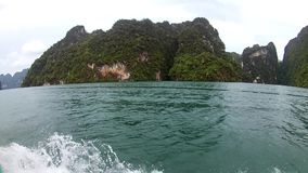 PHI PHI ISLAND - KRABI - THAILAND 2016 Year, December 29: Boat trip to tropical islands. The View from the Inside. Bow. Wave of a motor boat. Andaman Sea, Asia stock footage