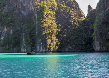 Phi phi island lagoon with a long tail boat Royalty Free Stock Image