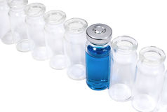 Phial with blue vaccine in the row of empty flacons Royalty Free Stock Photo