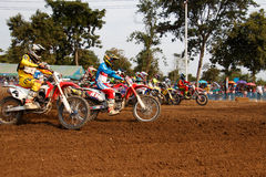 Phichit,Thailand,December 27,2015:Extreme Sport Motorcycle,The motocross competition,motocross rider start. Royalty Free Stock Photos