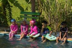 PHICHIT, THAILAND - NOV 3, 2018 : Children swimming and playing stock photos