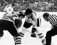 Phil Esposito and Stan Mikita. National Hockey League Hall of Famers Stan Mikita (21) and Phil Esposito (7) face-off.  (Image from B&W negative Stock Images