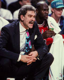Phil Jackson and Michael Jordan. Former Chicago Bulls head coach Phil Jackson with Michael Jordan in the background. (Image taken from color slide Royalty Free Stock Images