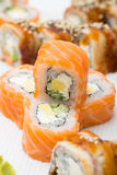 Philadelphia and canada roll on white plate with wasabi Stock Images