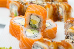 Philadelphia and canada roll on white plate with wasabi Stock Photos