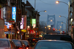 Philadelphia Chinatown. PHILADELPHIA, PENNSYLVANIA - JANUARY 29, 2008:  Night falls on Philadelphia's Chinatown district and the Ben Franklin bridge Royalty Free Stock Image