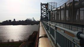 A Philadelphia cityscape from the Benjamin Franklin Bridge stock video footage