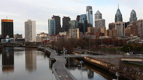 A Philadelphia cityscape with river in the foreground stock video footage