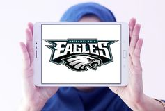 Philadelphia Eagles american football team logo. Logo of Philadelphia Eagles american football team on samsung tablet holded by arab muslim woman. The Royalty Free Stock Photo