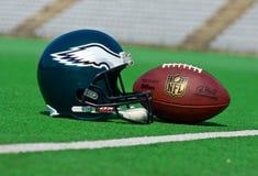 Philadelphia eagles NFL. ZAGREB , CROATIA - 13 AUGUST 2015 -  Philadelphia eagles equipment , ball and helmet on the green playing field , product shot Stock Image